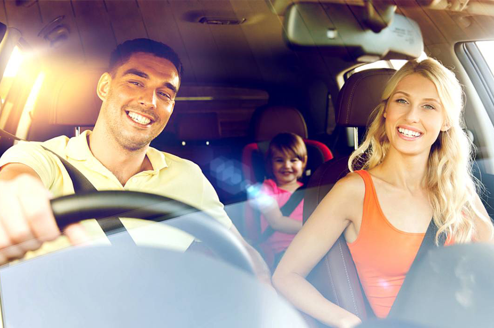 Happy Family driving a car with Sunflare