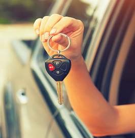 Holding-keys-to-car-outside-of-a-window