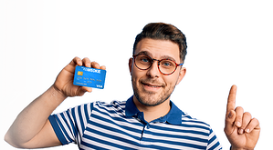 Young Man holding WEOKIE debit card with finger in air.psd-2