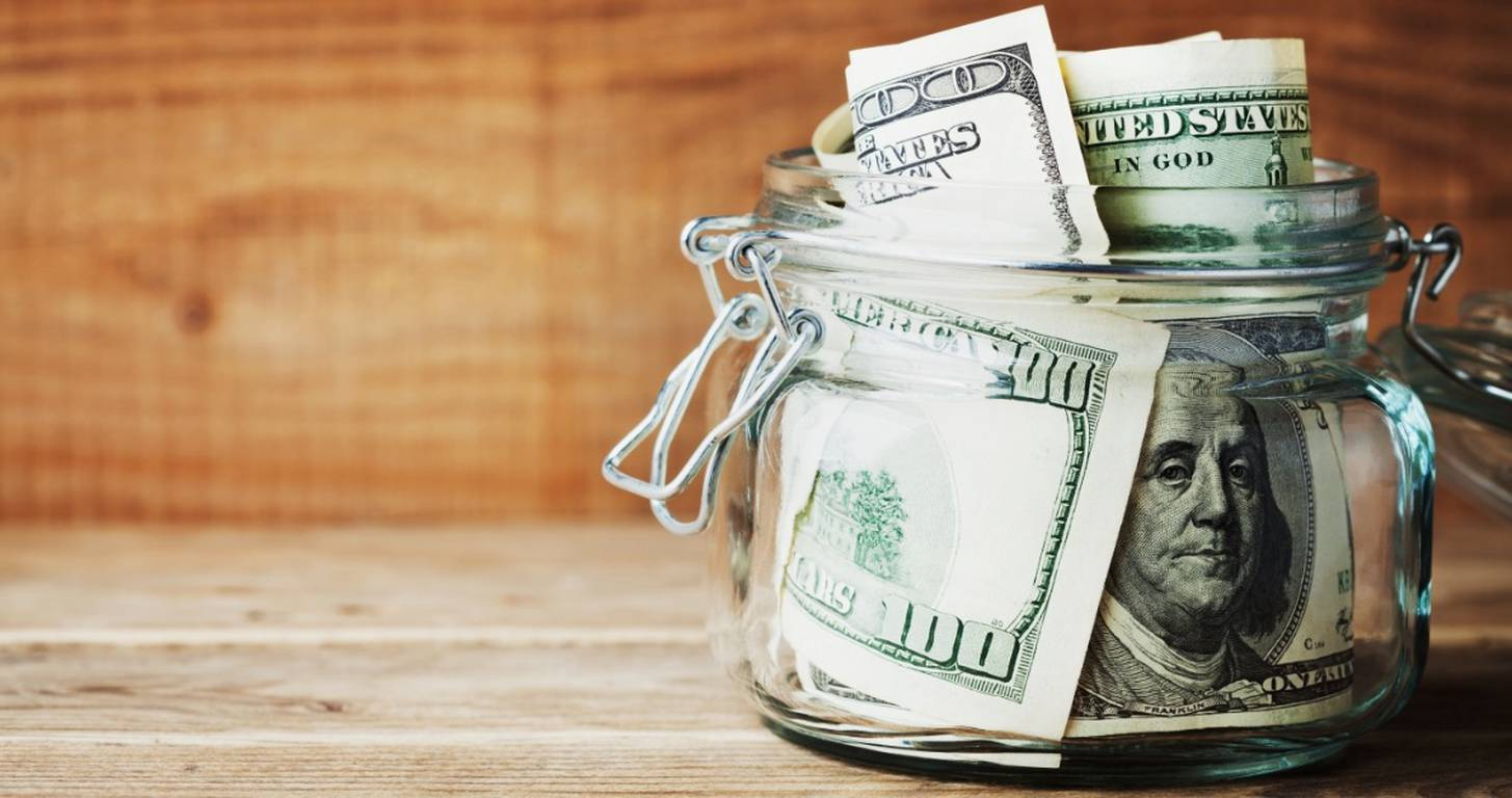 savings-dollar-in-glass-jar