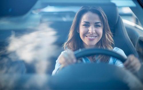 woman driving windshield